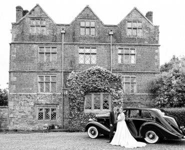 Bride and Groom in front of Acton Scott Hall (credit Catherine Evans Photography)